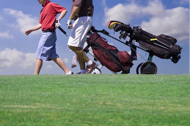 Men with remote control golf carts